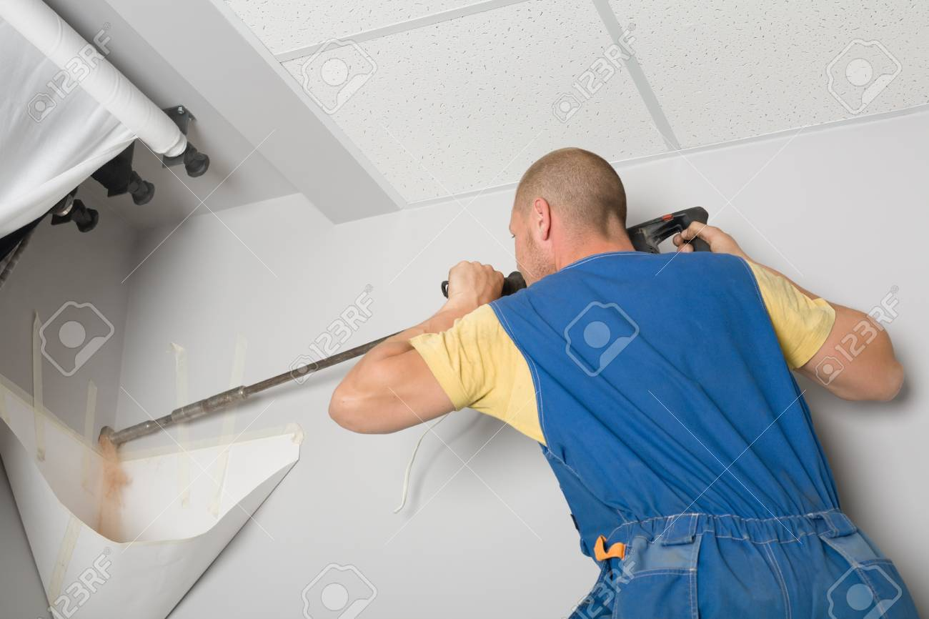 Setup man drills wall rock drill. Work on installing a new air conditioner. Stock Photo - 10298839