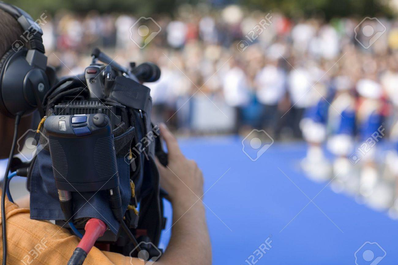 Operator television camera during a public event space. Stock Photo - 10301310