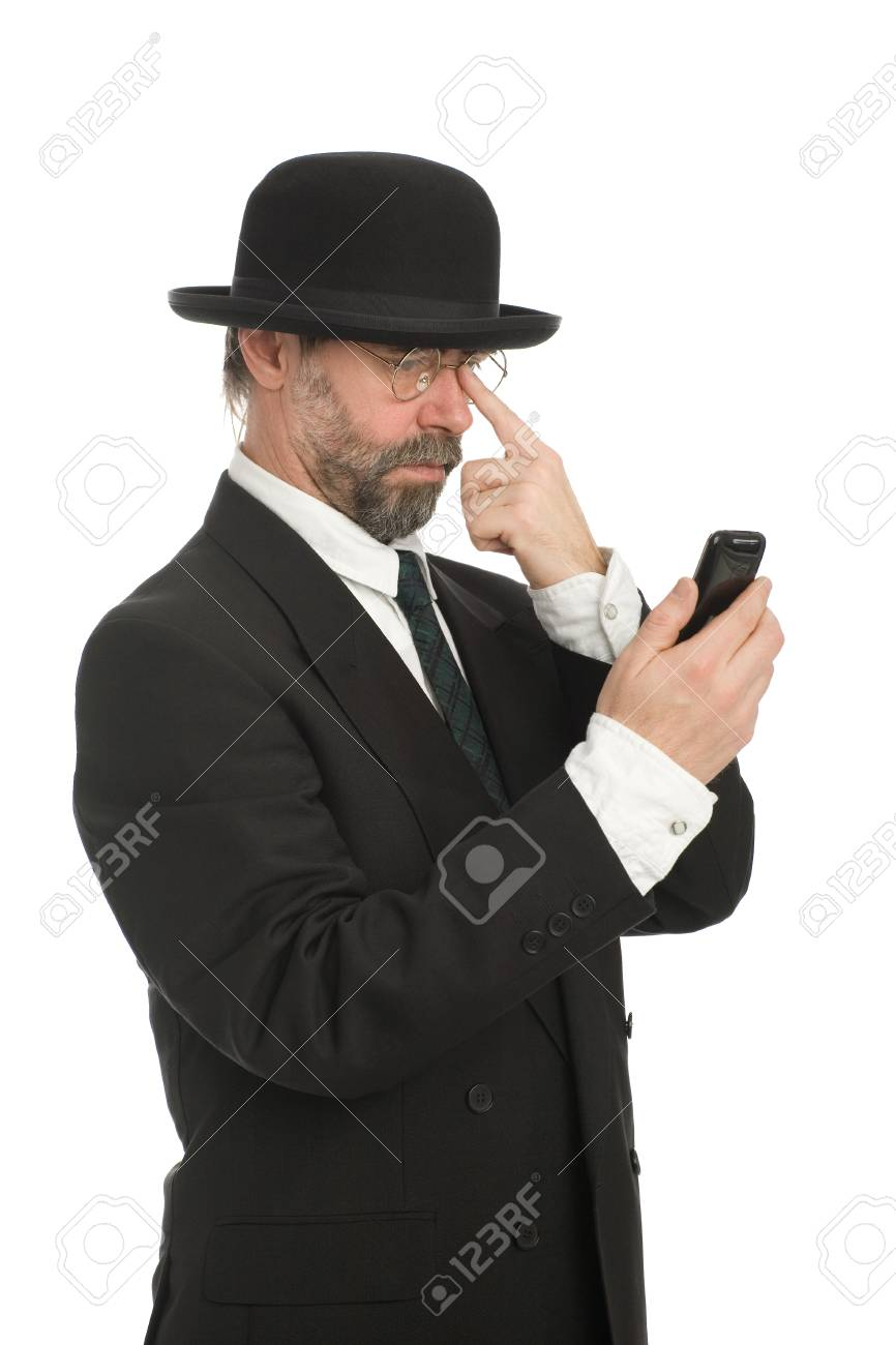 Middle-aged businessman looking at his smartphone. Stock Photo - 10407834