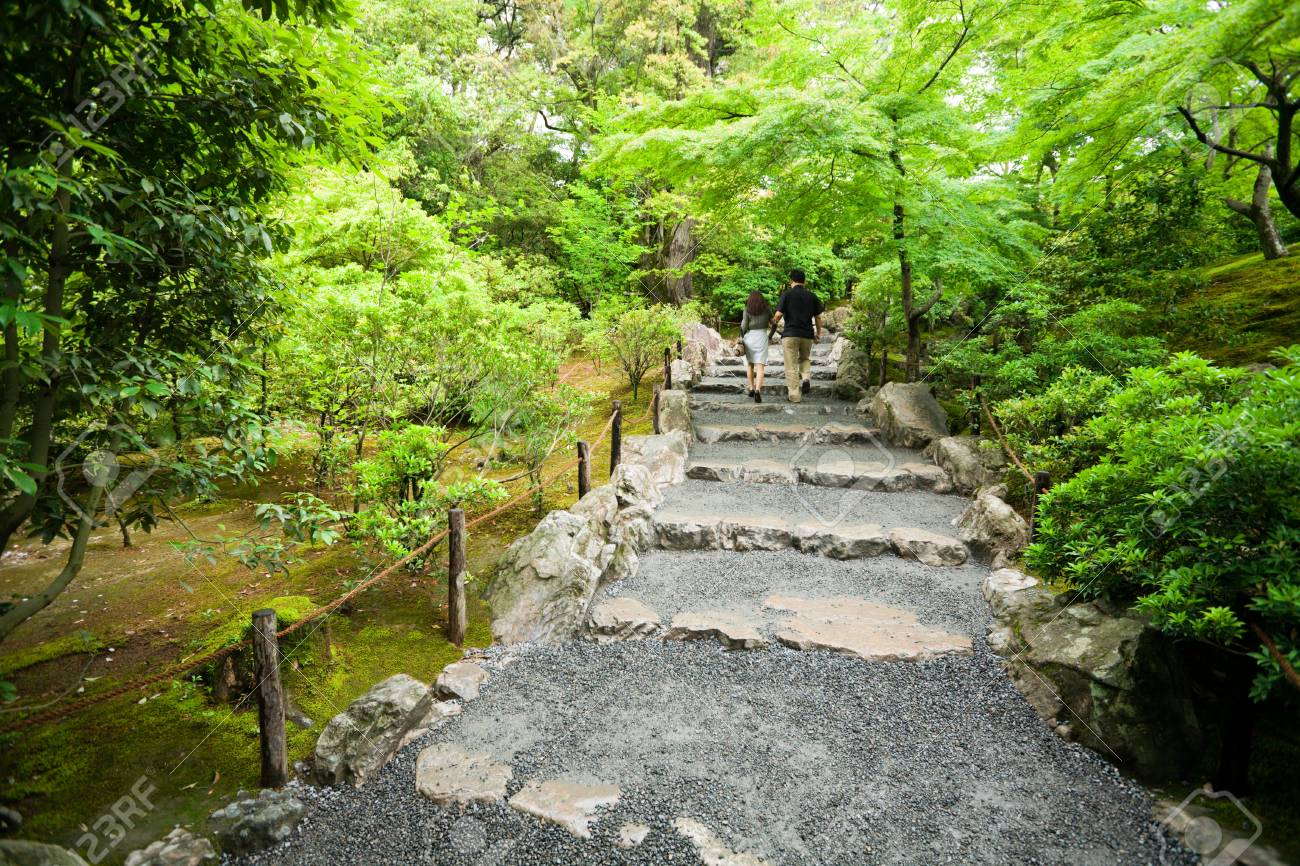 The guy and the girl go on an old stone staircase Stock Photo - 10531570