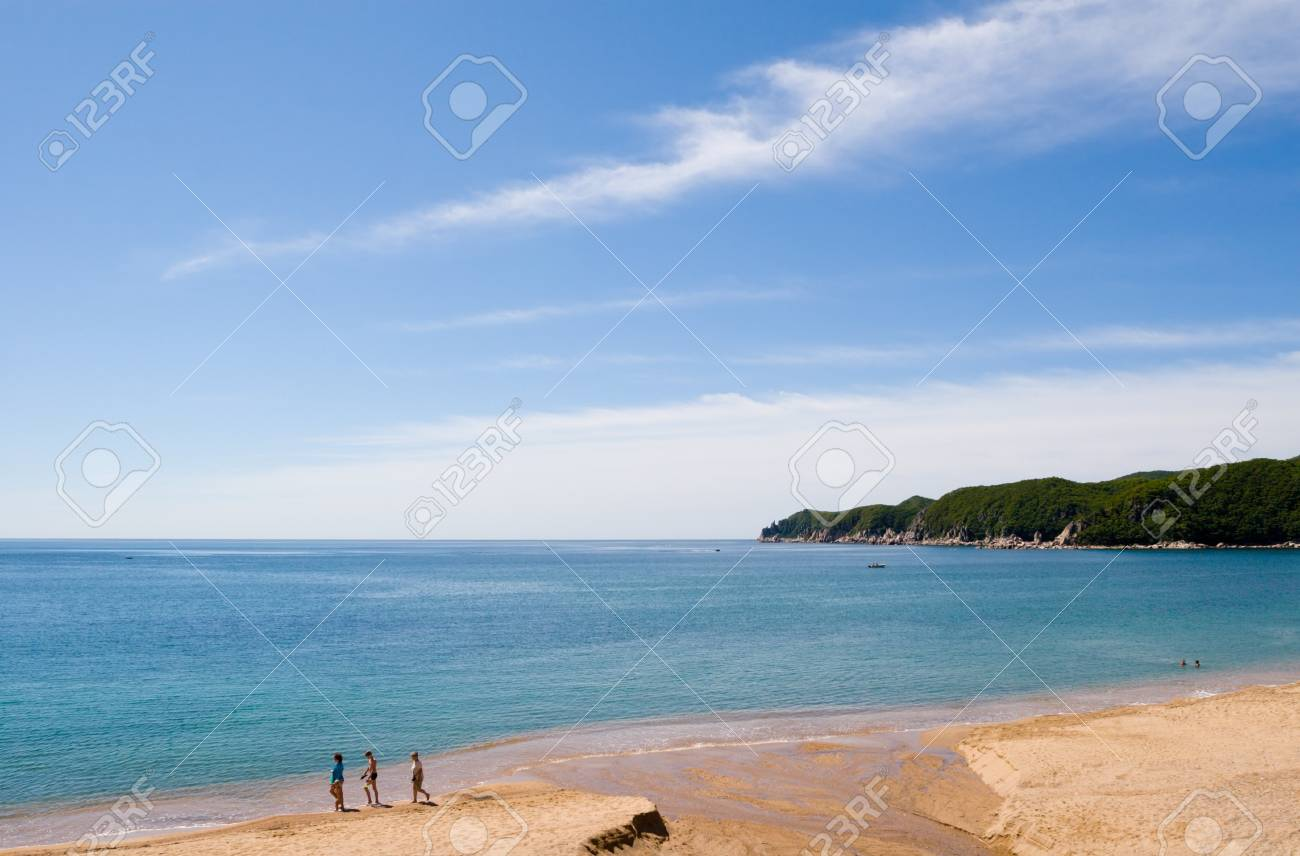 Gulf in summer day. On a beach there are people. The small river flows into the sea. Stock Photo - 10532650