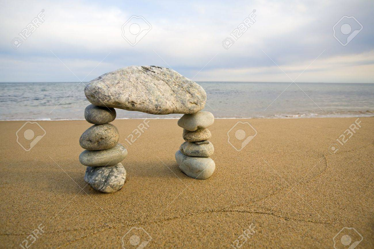 Abstract arch from a natural stones on a background of the sea Stock Photo - 10532361