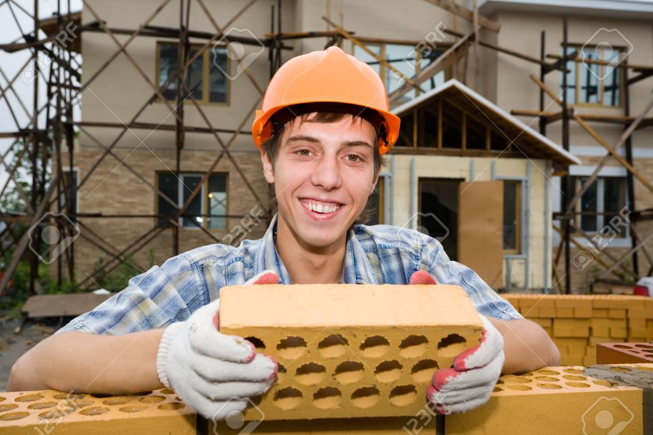 Mason on construction of a house. Stock Photo - 10532101