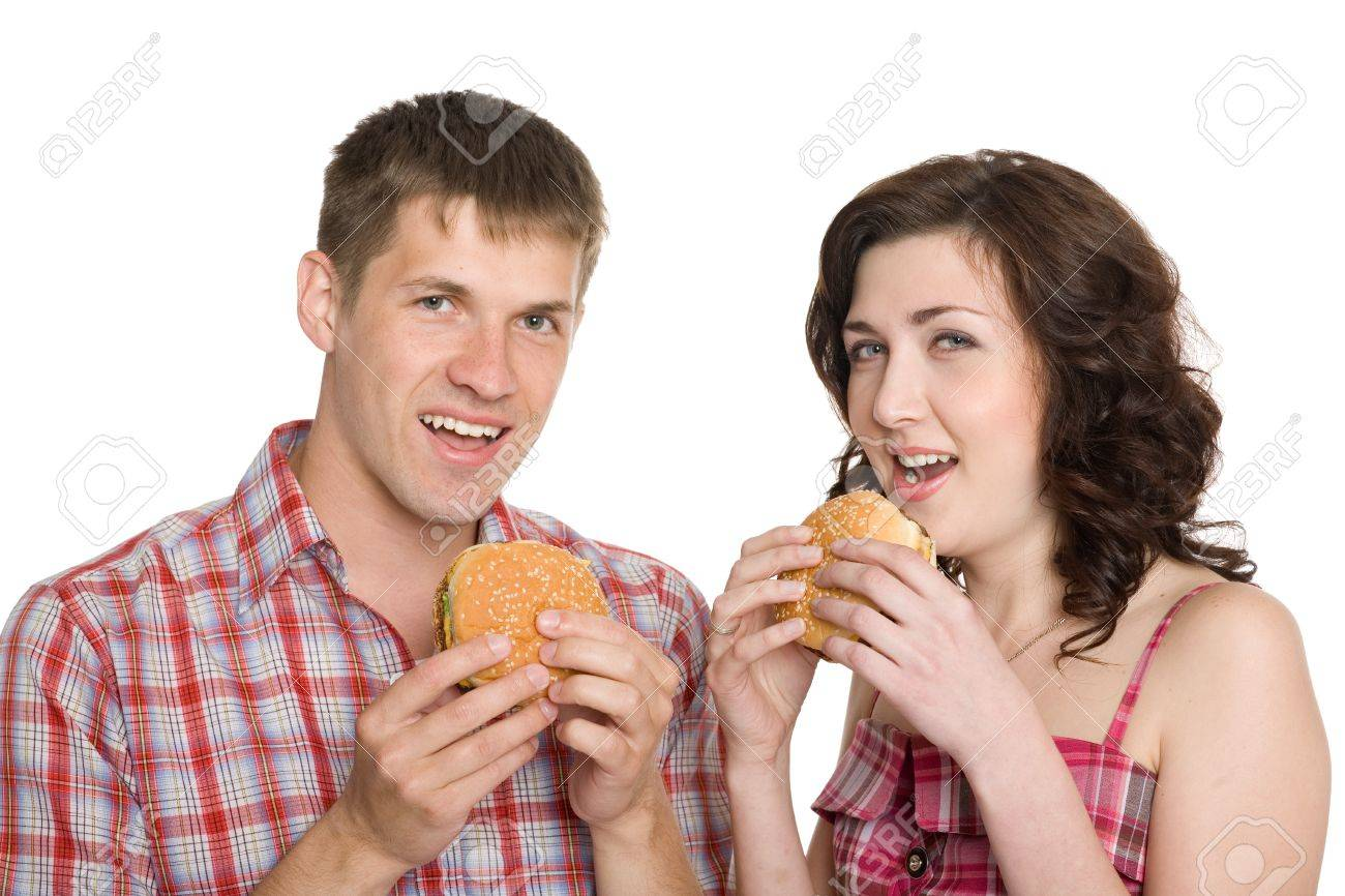 Girl and a guy eating hamburgers/ Isolated on white. Stock Photo - 10551472