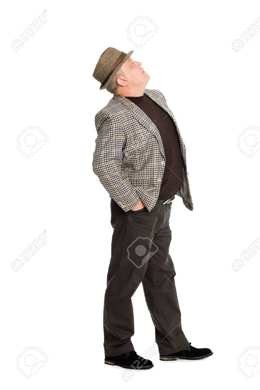 An elegant man in a hat looking up. Stock Photo - 11720632