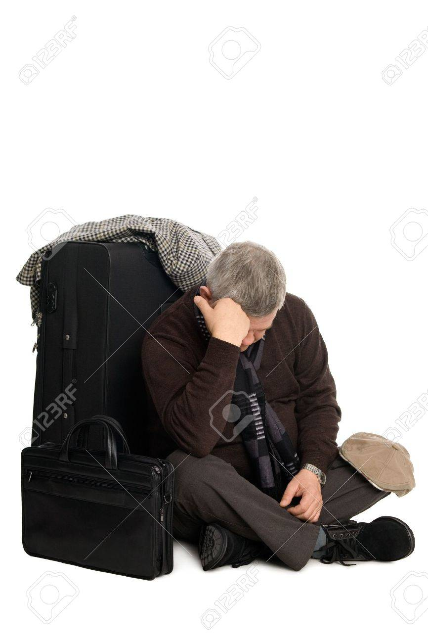 Tired of waiting for a mature man landing on the aircraft sitting on the floor. Stock Photo - 11720677