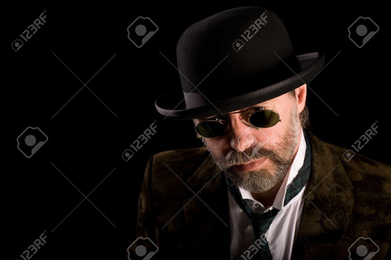 Middle aged man in vintage sunglasses pince nez and bowler hat Stock Photo - 13195945