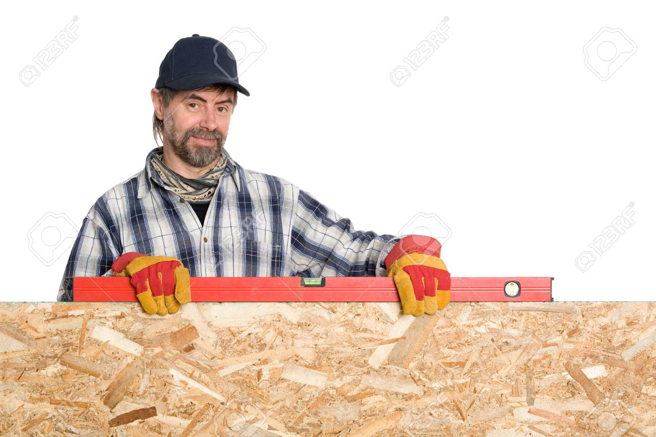 Carpenter holds a builder s level over the plywood. Stock Photo - 13701867 e9890cd6ad37
