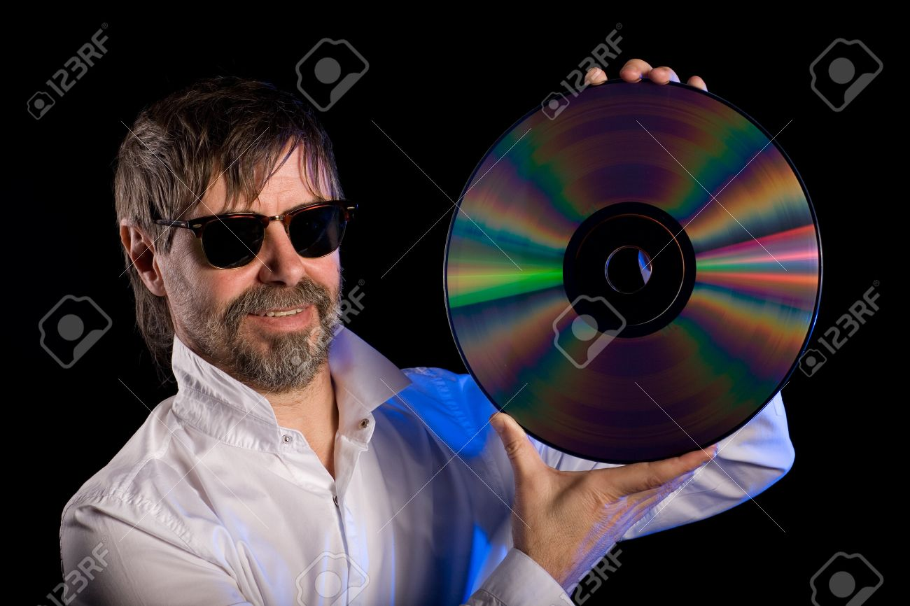 Lover of music with the retro laser disc. Stock Photo - 13871753