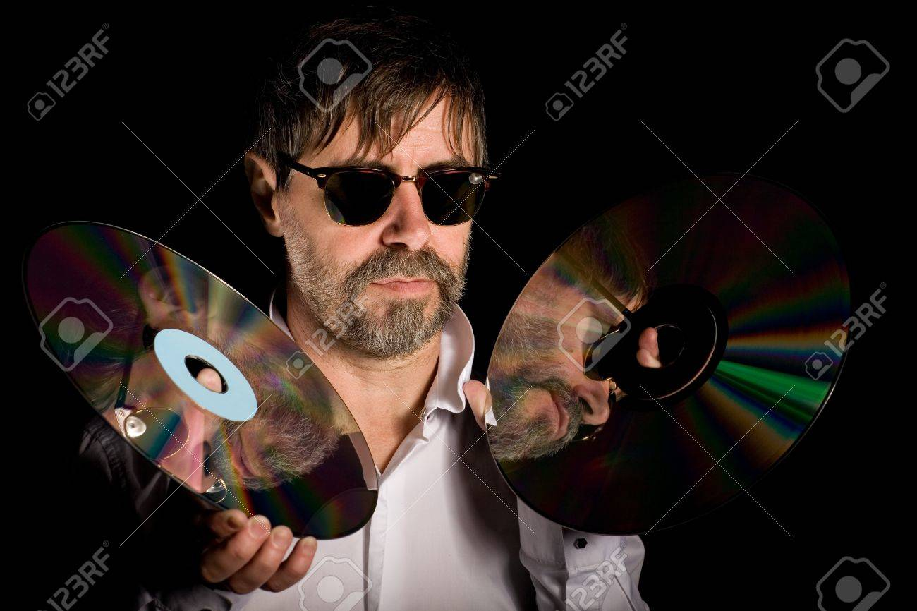 Man holds a retro laser discs on a black background. Stock Photo - 13871752