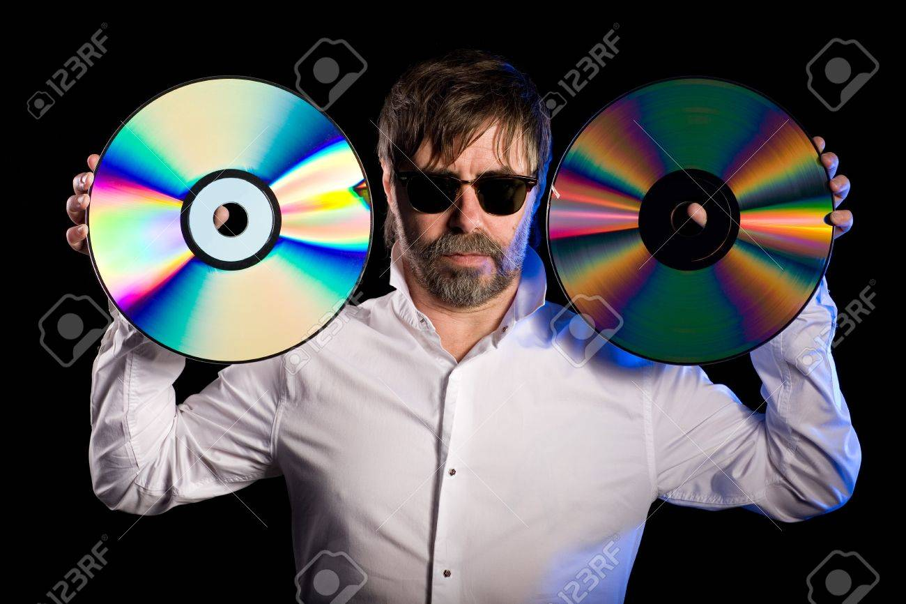 Man holds a retro laser discs on a black background. Stock Photo - 13871757
