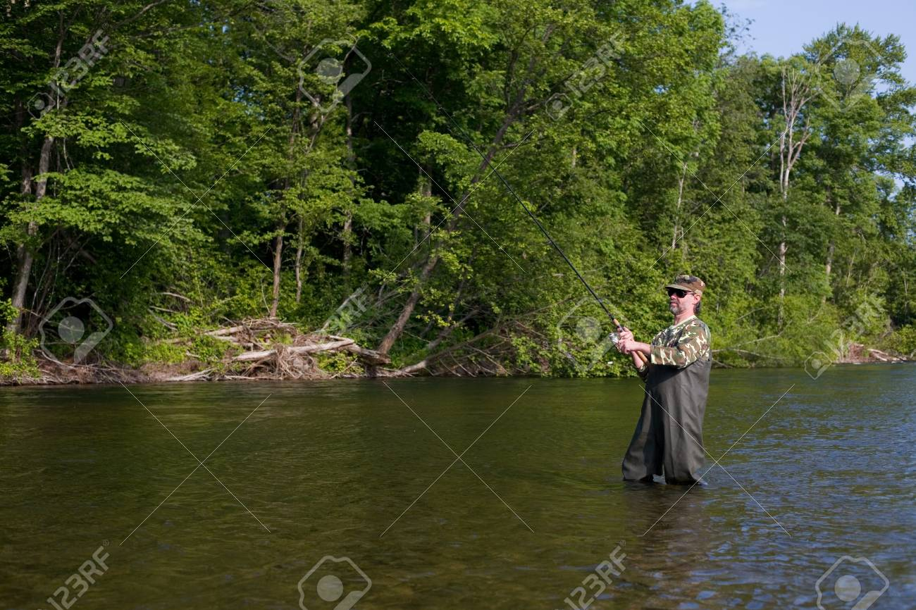 Fisherman catches of salmon in the river. Stock Photo - 17718913