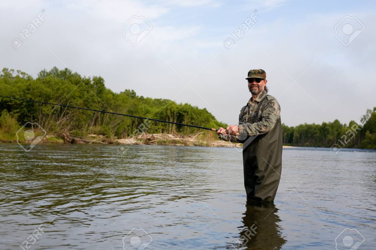 Smiling fisherman on the river during the salmon fishing Stock Photo - 17750578