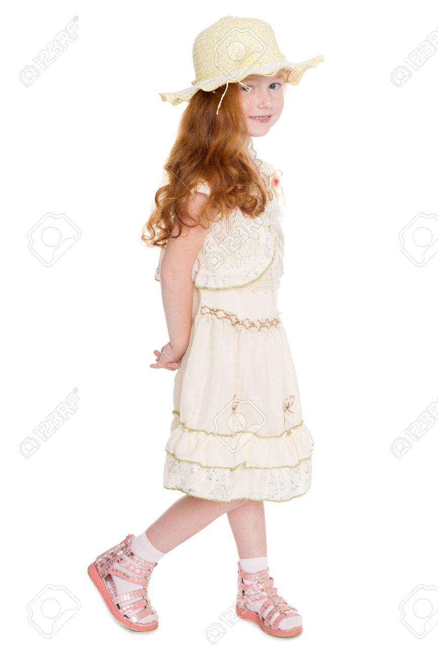 Little redhead fashionista in a summer dress and hat. Girl is six years.  Stock 14c84b64fc1