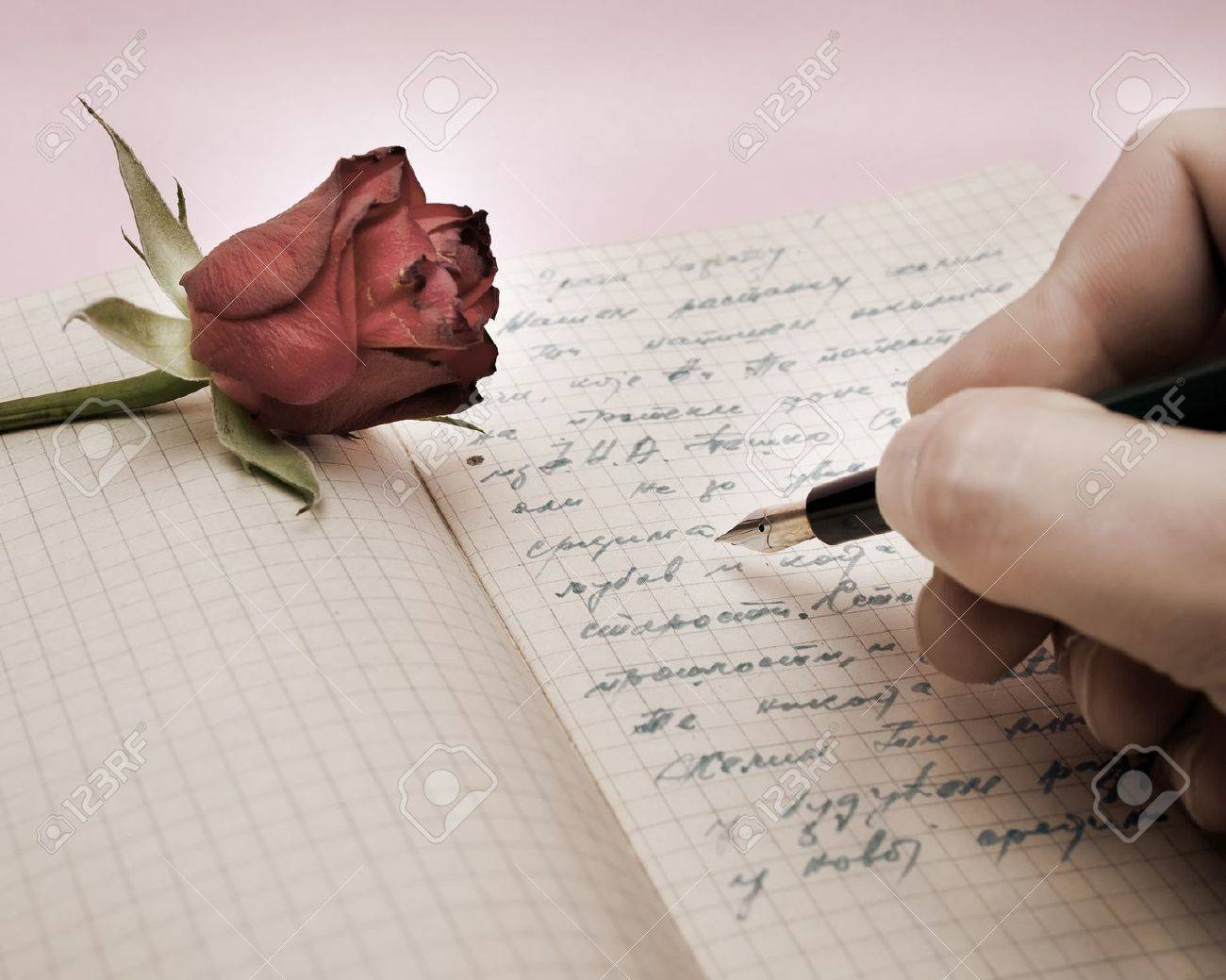 Write a love letter with a rose over pink background stock photo stock photo write a love letter with a rose over pink background spiritdancerdesigns Choice Image