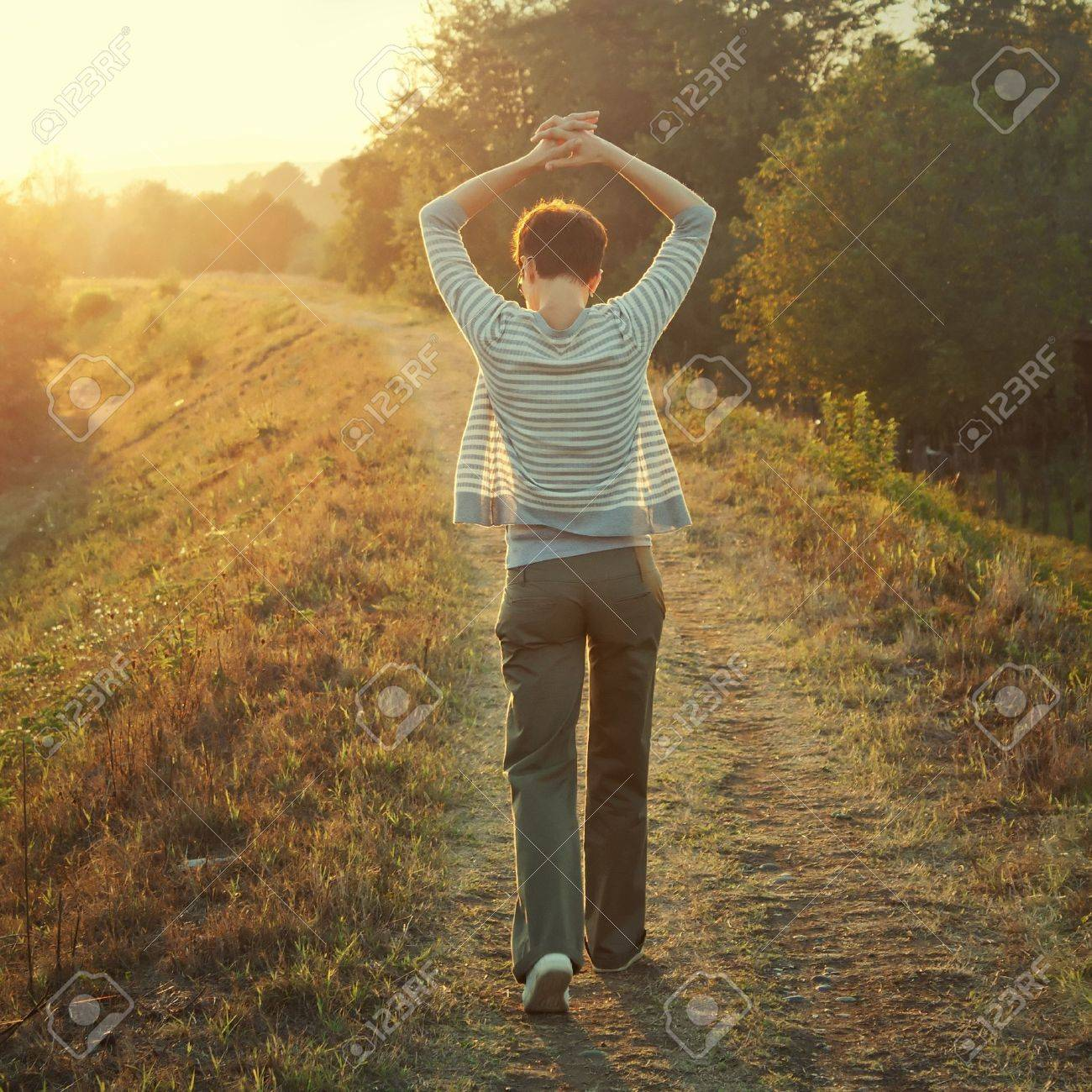 woman walking in nature late afternoon,tinted photo Stock Photo - 10684934