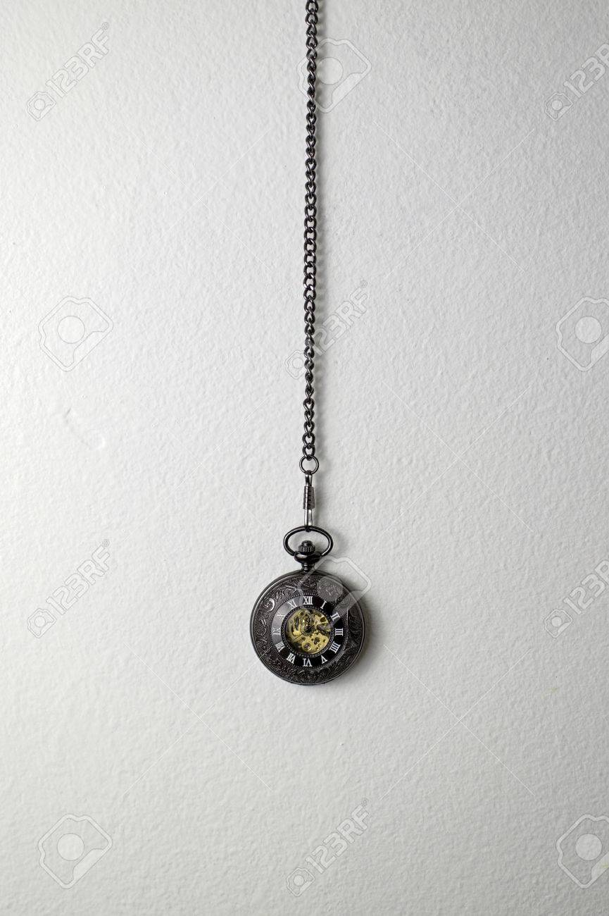 Old Pocket Watch Hanging On The White Wall Stock Photo Picture And