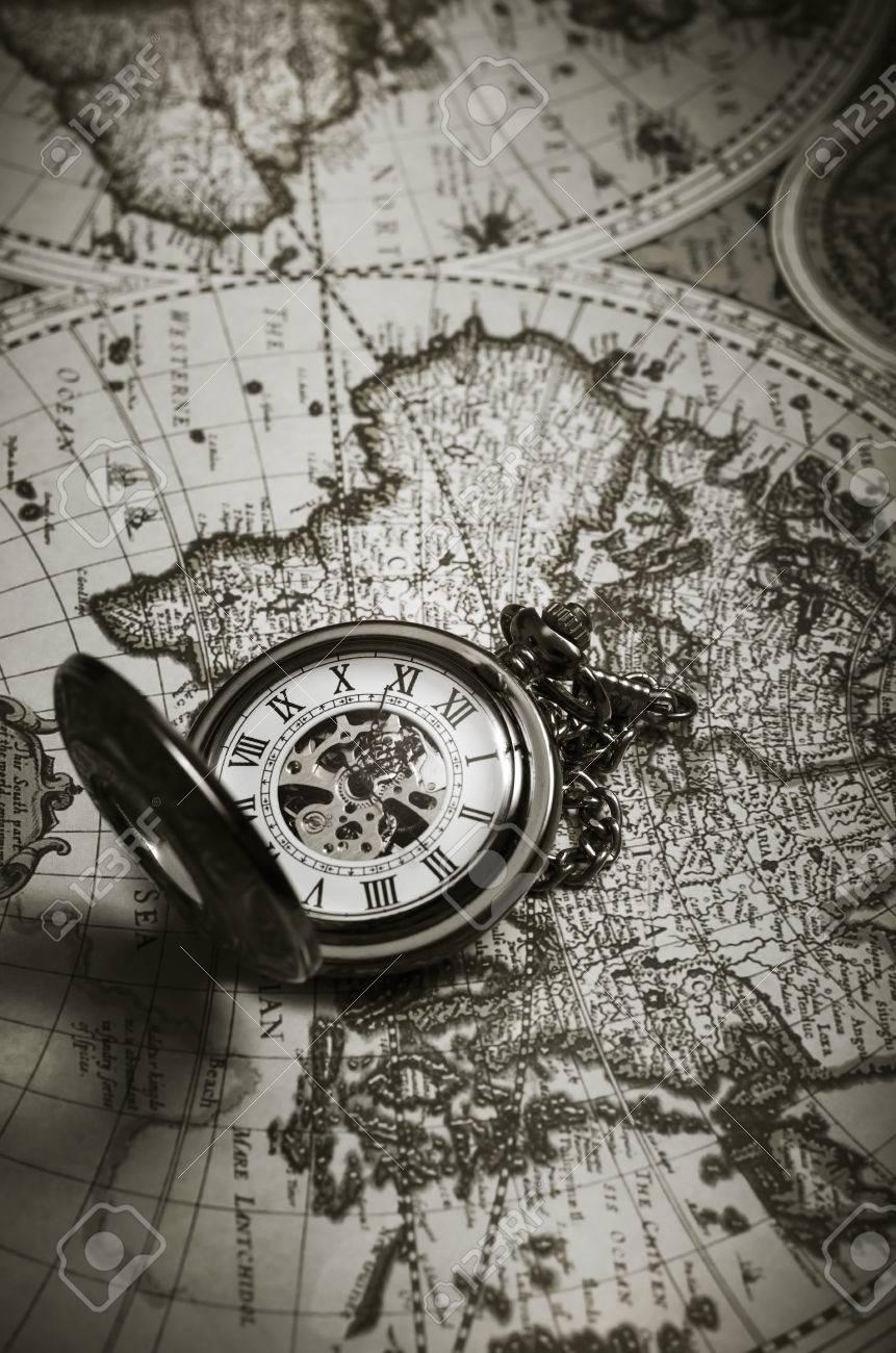 Vintage Antique Pocket Watch On Old Map Background Close Up Stock
