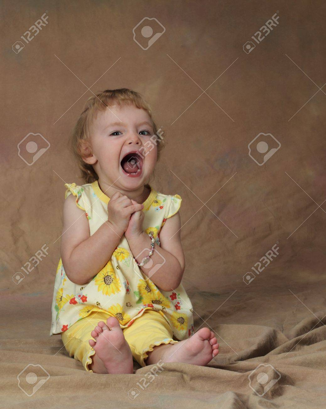 A young girl opens her mouth in glee Stock Photo - 16514309