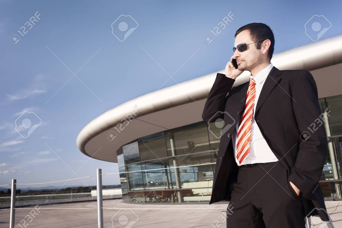 Business person on phone. - 130845190