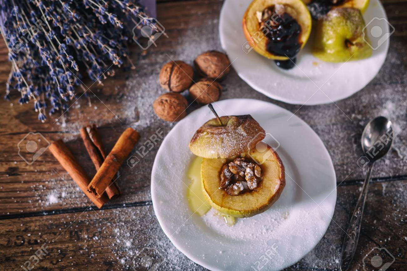 Stuffed Baked Apple With Nuts Honey And Chocolate On White