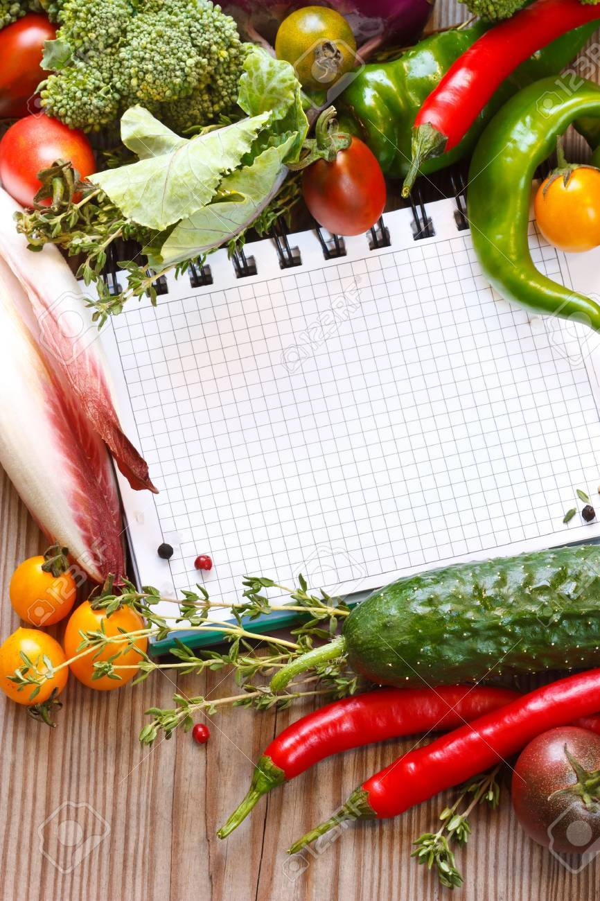 Open notebook and fresh garden vegetables and herbs. Stock Photo - 10439604