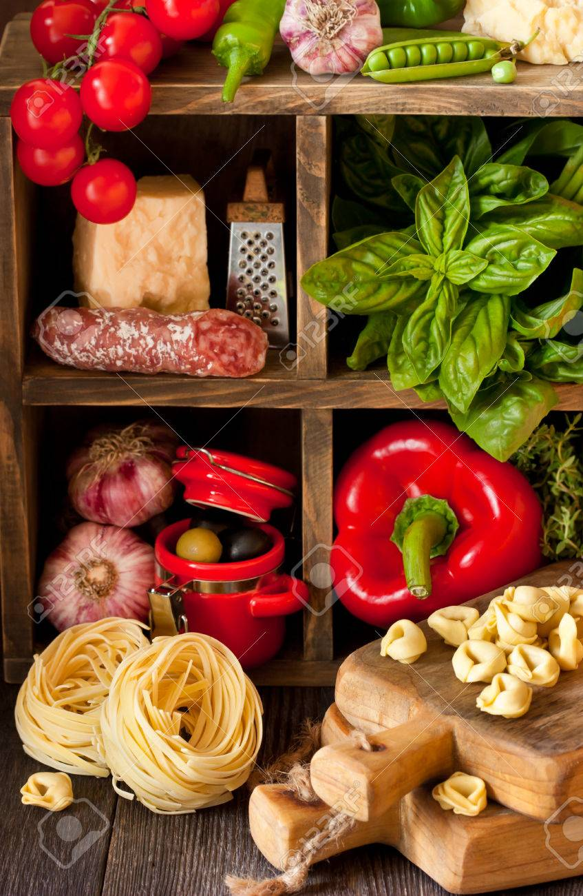 Italian Food. Fresh Food Ingredients For Cooking On A Rustic Kitchen. Banco  De Imagens