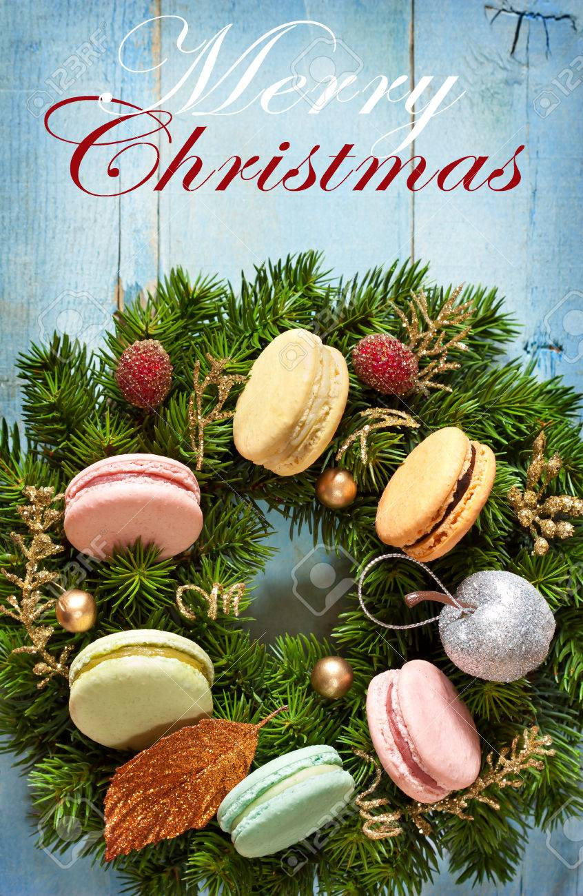 Wreath from old christmas cards - Christmas Wreath With Macarons Cakes And Decorations On An Old Blue Wooden Board Christmas Card