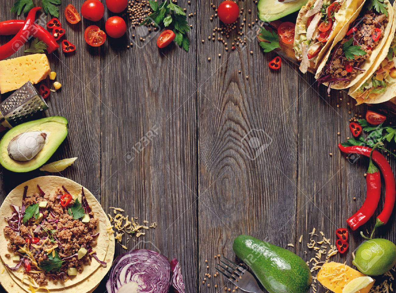 Fresh delisious mexican tacos and food ingredients. Stock Photo - 49634456