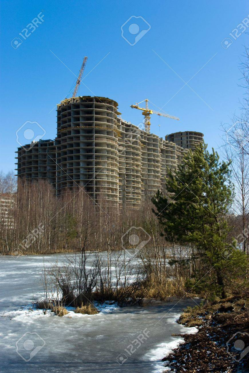 Under construction residential house on river bank in suburb of Saint-Petersburg, Russia Stock Photo - 5093796