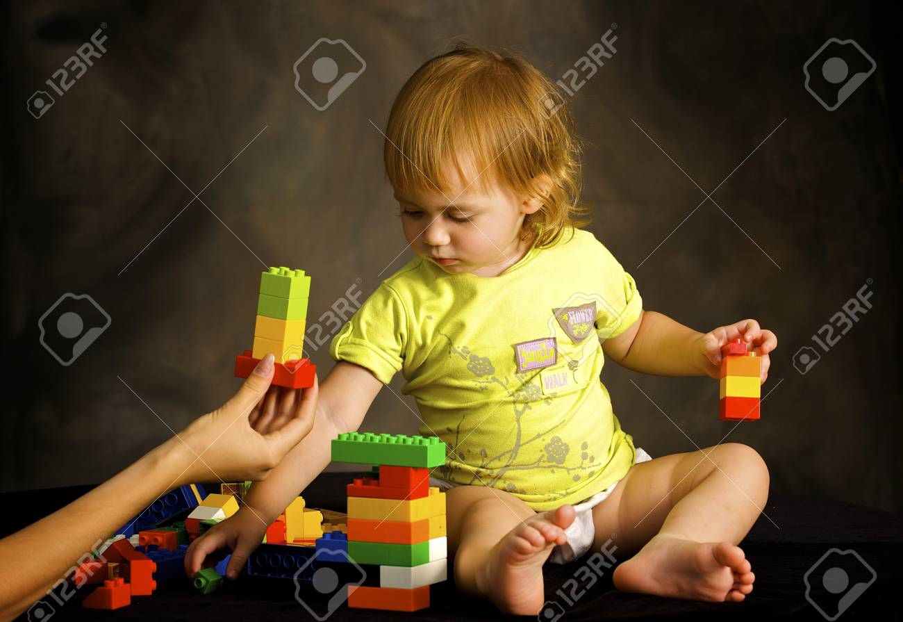 Small girl plays with the designer Stock Photo - 4042152