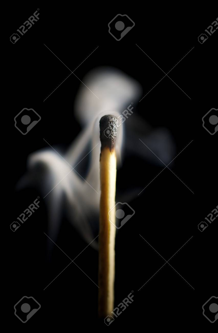 Wooden match burning on a black background Stock Photo - 4048147