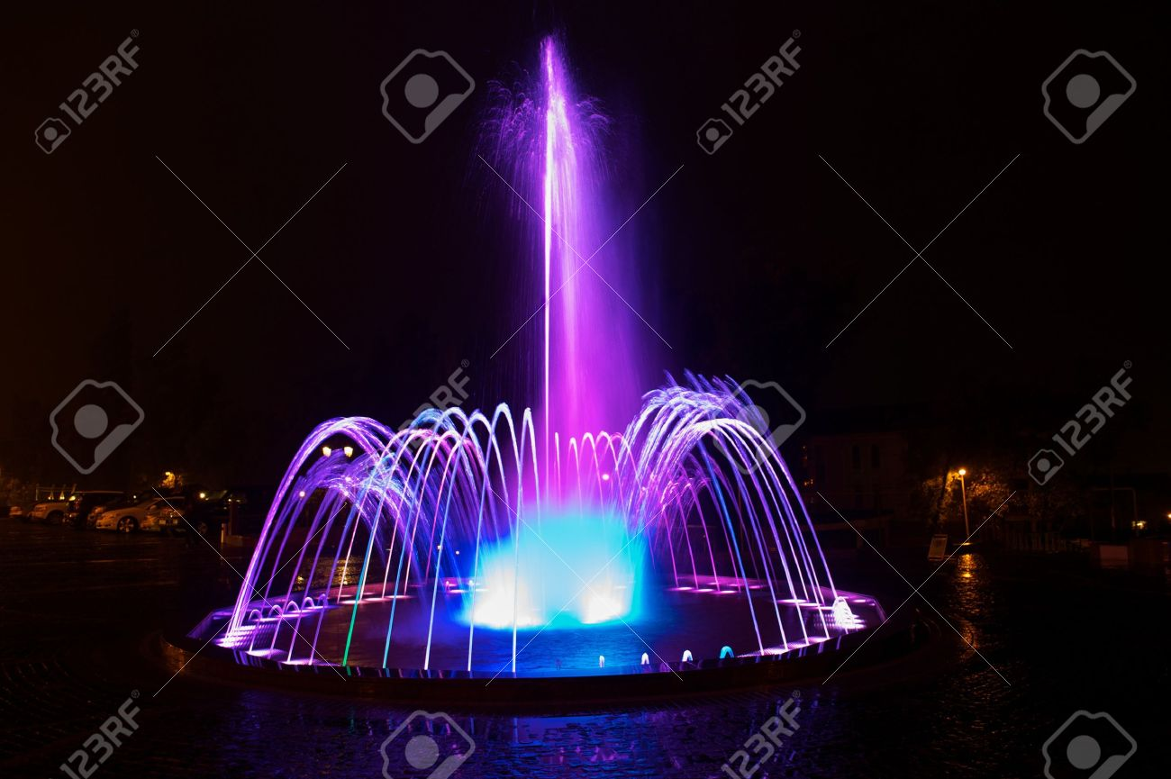 Colored water fountain at night Stock Photo - 7988275