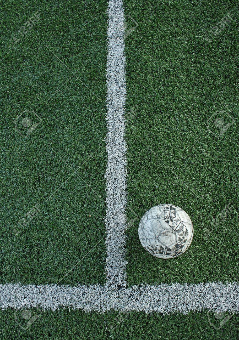 Artificial grass soccer field and old football Stock Photo - 8662619