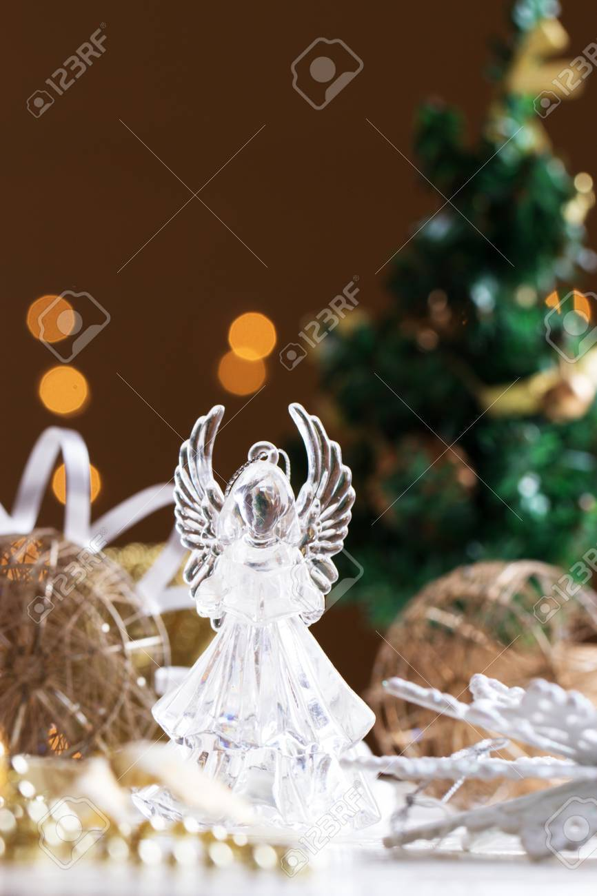 Christmas Angel. Crystal Angel On The Background Of Christmas Gold Balls.  New Year Decoration