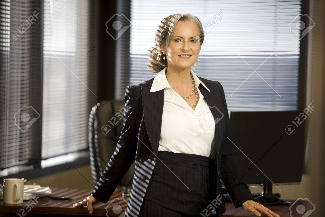 Close of attractive senior woman in the office. Stock Photo - 11354133