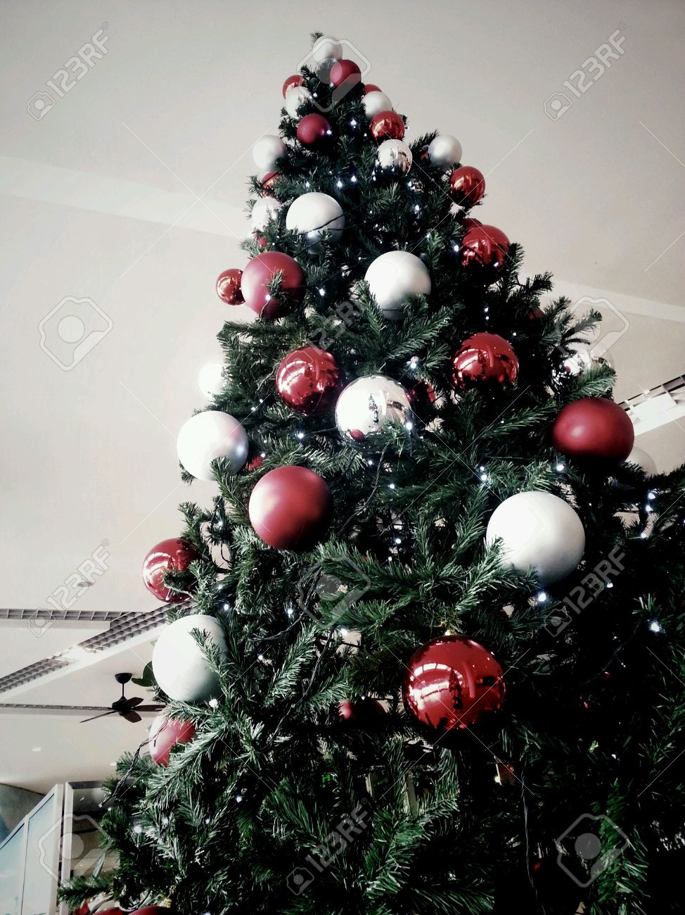 huge christmas tree with red and silver balls decorations stock photo 24347948