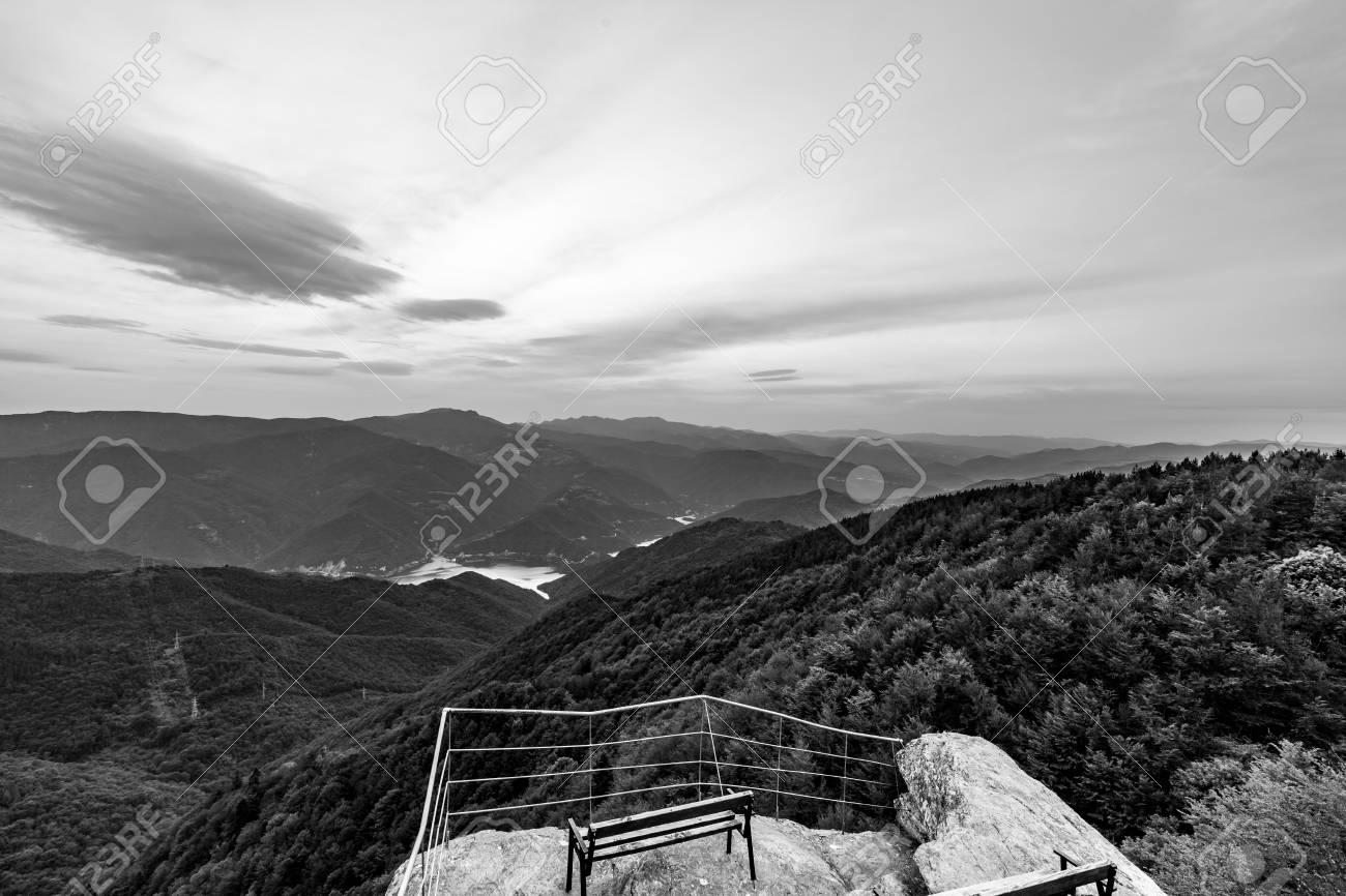 Calm scenery springtime black and white landscape high altitude observation deck view with picturesque rocks