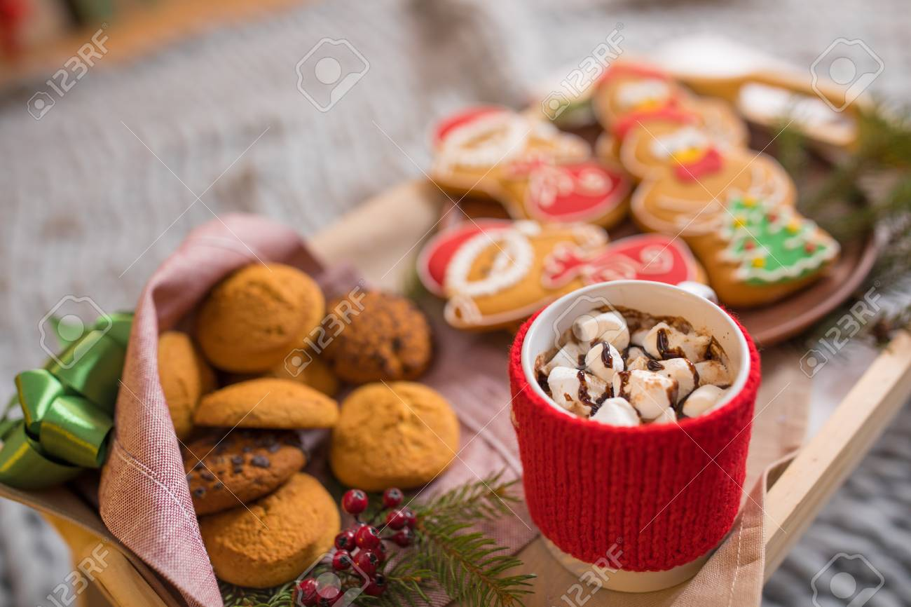 Close Up View Of Wooden Tray With Christmas Cookies And Hot Chocolate