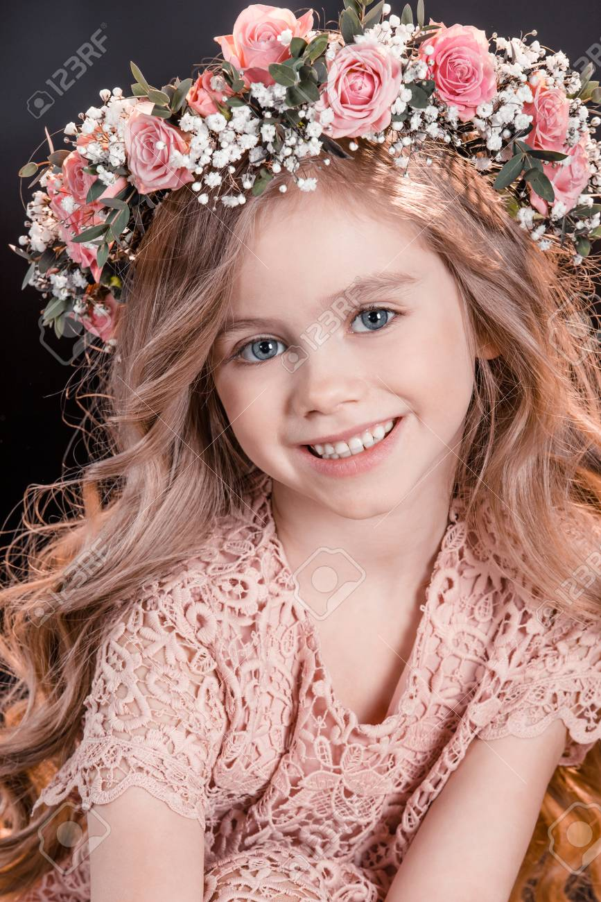 Smiling Girl With Flowers Wreath On Head On Black Stock Photo