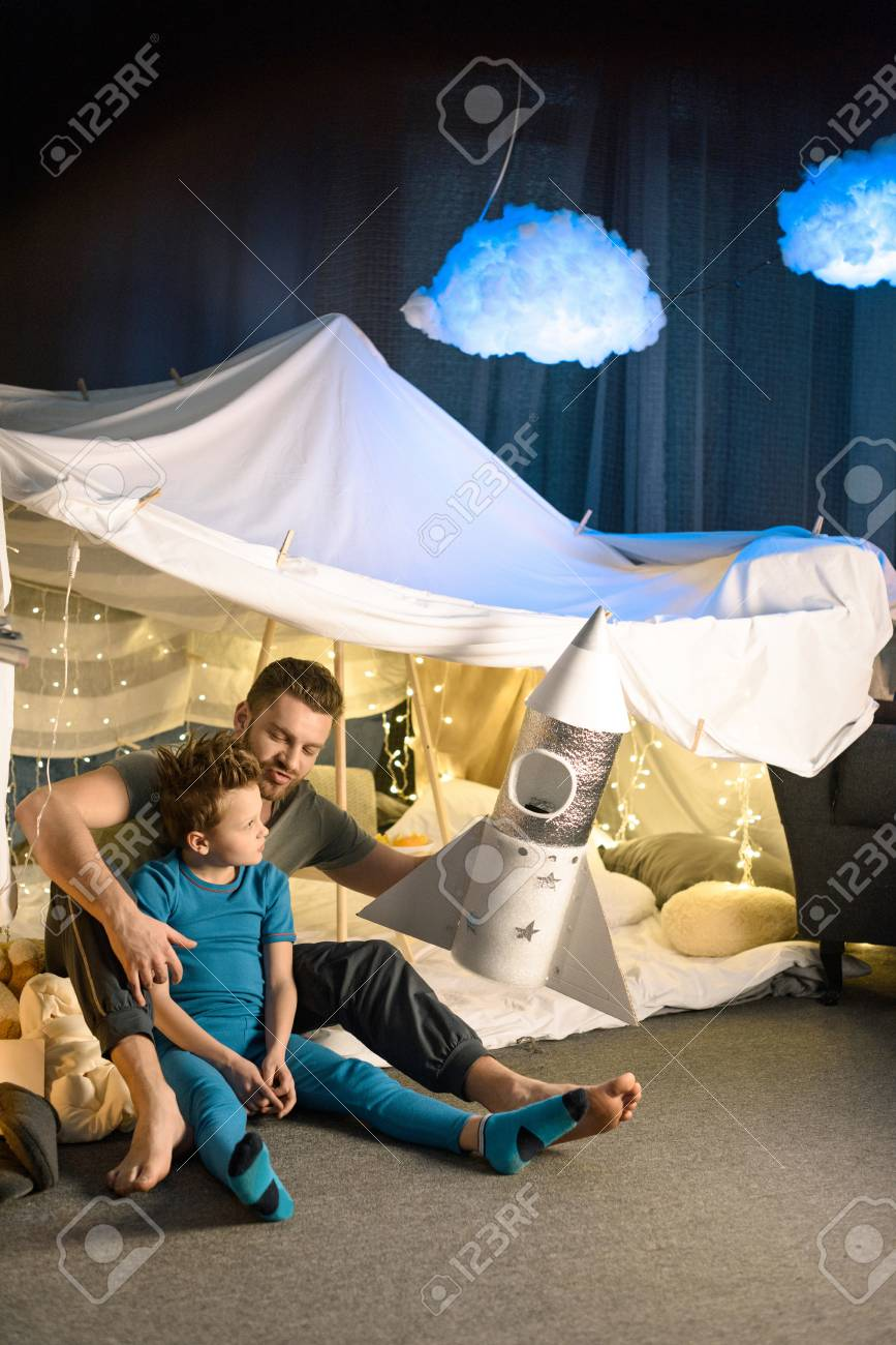 Father And Son Sitting Together In Blanket Fort And Playing With Stock Photo Picture And Royalty Free Image Image 77858131