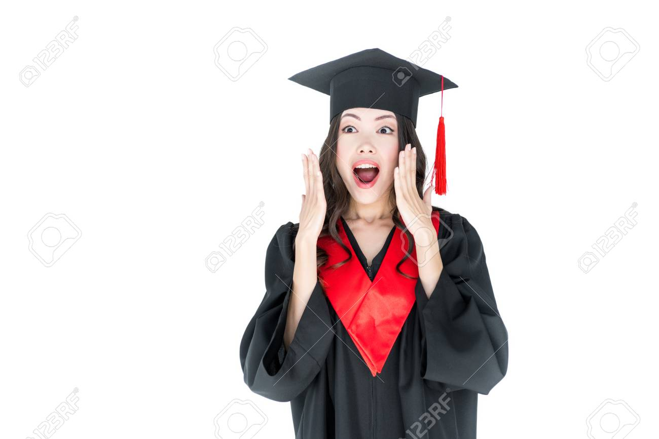 Young Brunette Woman In Graduation Gown And Mortarboard Stock Photo ...