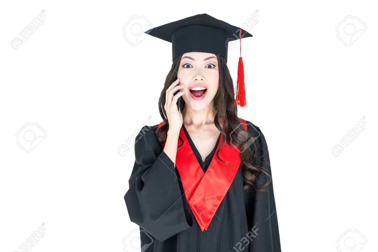 Young Brunette Woman In Mortarboard And Academic Gown Looking ...