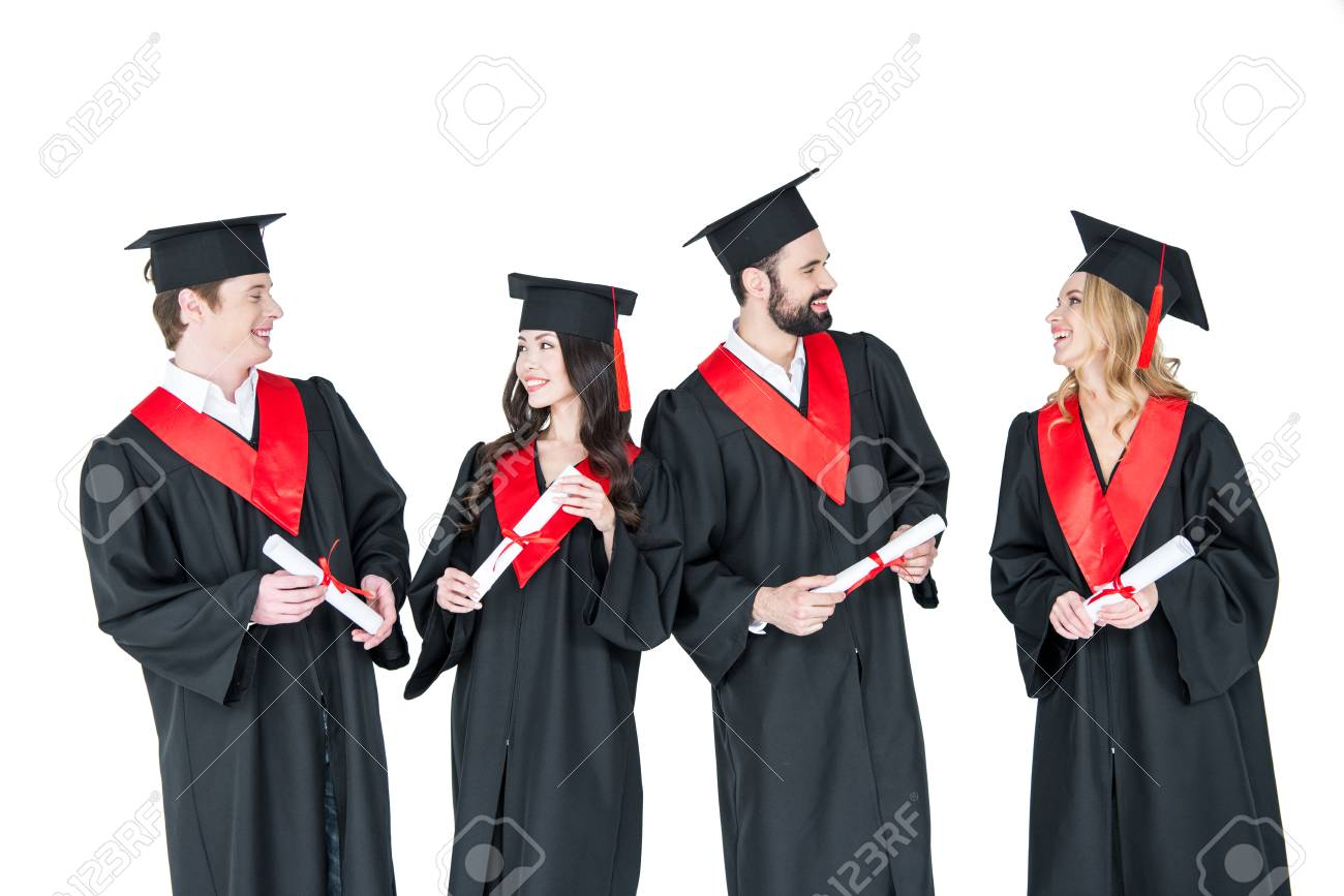 Young Men And Women In Graduation Gowns And Mortarboards Holding ...