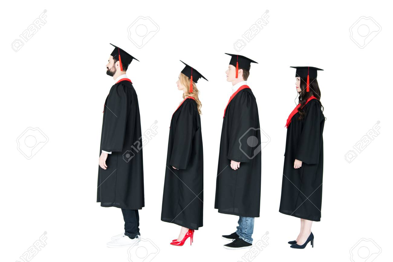 Students In Academic Caps And Graduation Gowns Standing In A.. Stock ...
