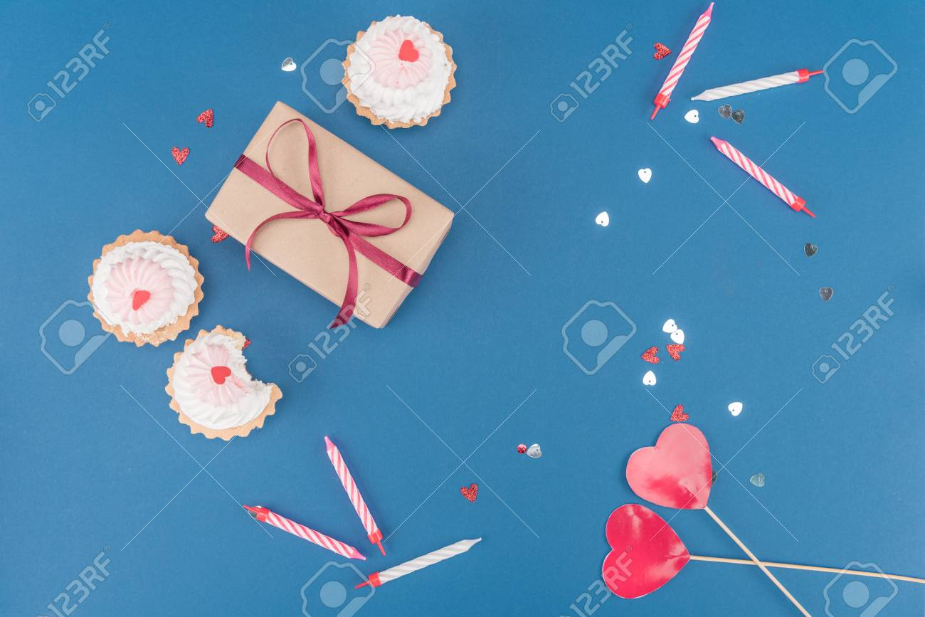 Top view of gift box cakes and candles isolated on blue birthday stock photo top view of gift box cakes and candles isolated on blue birthday party concept negle Choice Image