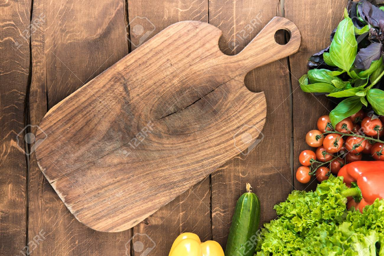 cutting board with food food photography stock photo vegetables and greens with wooden cutting board healthy food background vegetables and greens with wooden cutting board food