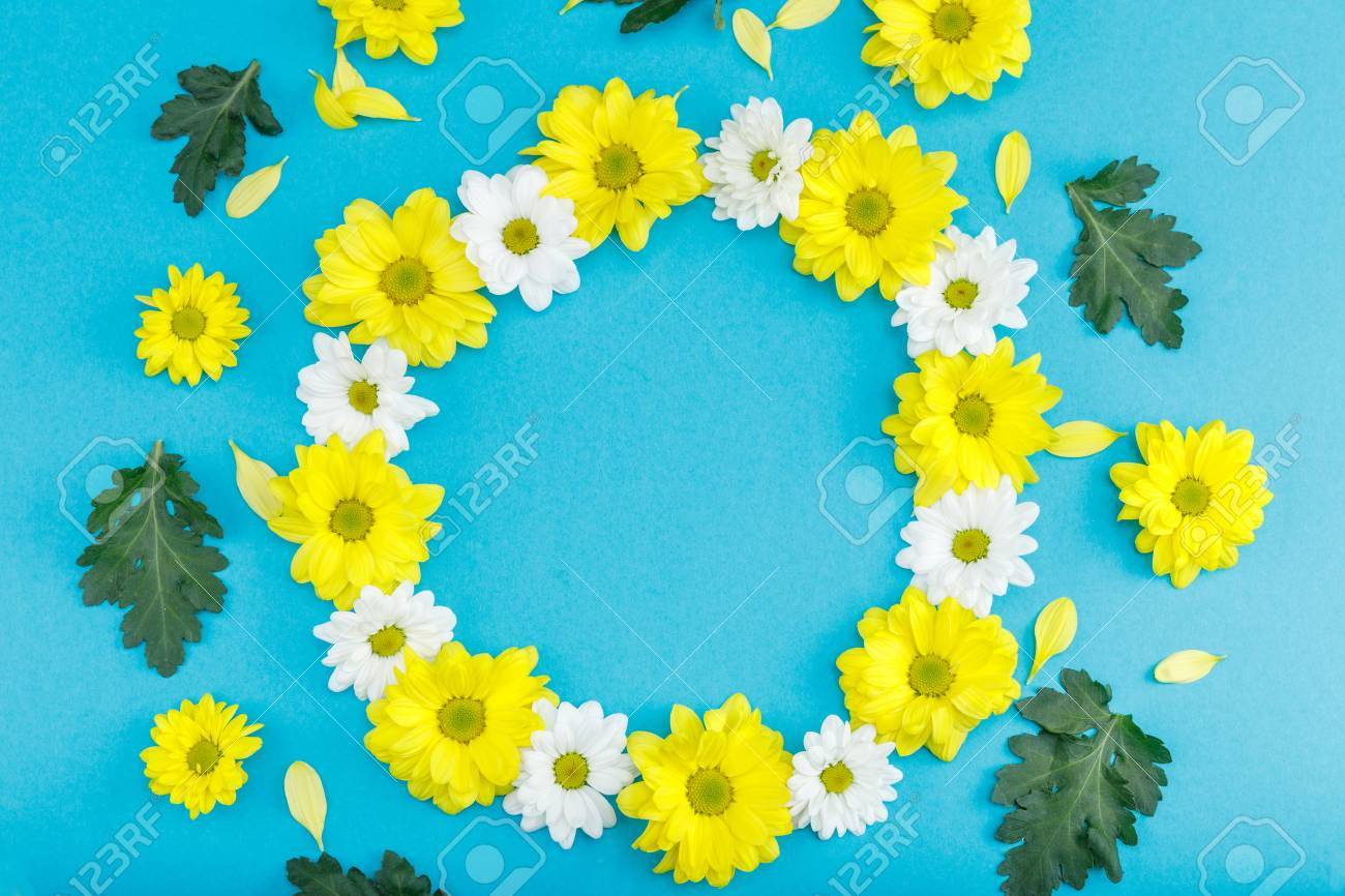 Top view of beautiful floral wreath with yellow and white flowers stock photo top view of beautiful floral wreath with yellow and white flowers isolated on blue izmirmasajfo
