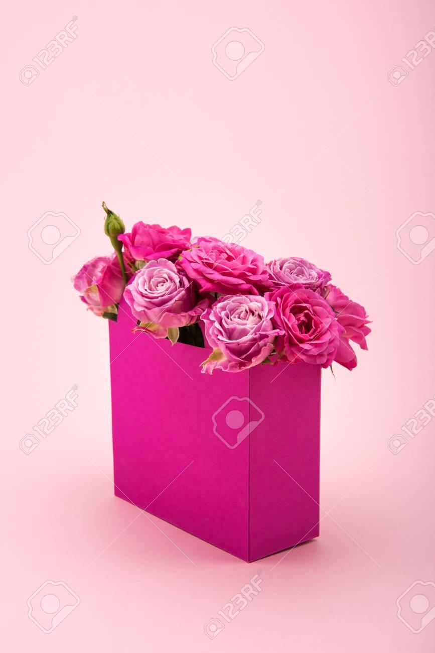 Beautiful Blooming Rose Flowers In Decorative Paper Bag Arranged