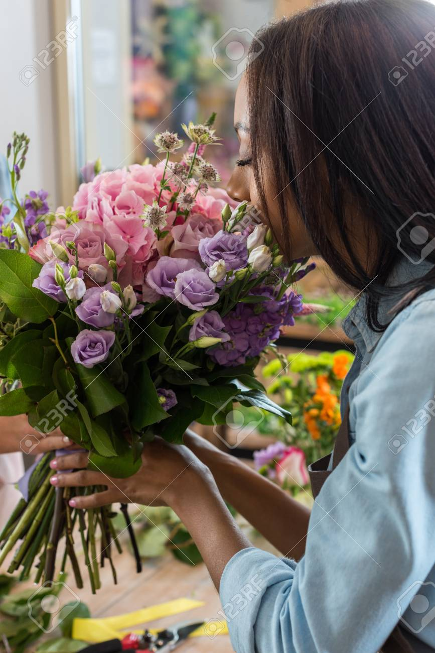 African american woman smelling beautiful flowers in flower shop african american woman smelling beautiful flowers in flower shop stock photo 84824676 izmirmasajfo